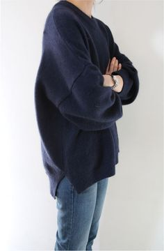 Death by Elocution; navy sweater and blue denim.