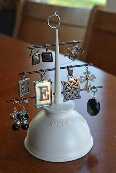 Oil funnel turned into a jewelry holder, a great idea.  These would also make the cute christmas trees!