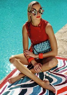 Maud Welzen is ready for pool season in the February 2017 issue of ELLE Germany. Photographed by Joshua Jordan, the blonde beauty wears retro bikini looks. Posing at the pool, Maud channels 50's and 60's style in the designs of Michael Kors Collection, Prada, Dolce & Gabbana and more. The model looks like a movie …
