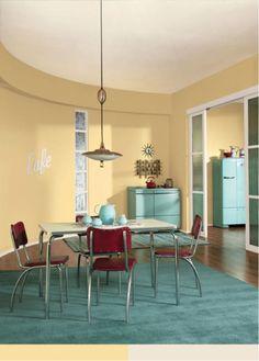 Sunbeam Yellow (SW 0078) brightens the walls of this retro inspired kitchen.