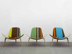 PAUL SMITH & MAHARAM. Carl Hansen & Son.  To celebrate the 100th anniversary of Hans J. Wegner, Paul Smith and Maharam are collaborating with Danish furniture manufacturer Carl Hansen & Son on a Limited Edition Collection. Applying the new textile Big Stripe and Stripes by Paul Smith to the iconic Shell Chair and other furniture from Carl Hansen & Son gives a bold injection of colour to these classic Wegner designs.