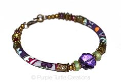 Purple, red, mint and bronze bracelet with glass and handmade fabric beads by PurpleTurtleStore on Etsy https://www.etsy.com/au/listing/275125780/purple-red-mint-and-bronze-bracelet-with