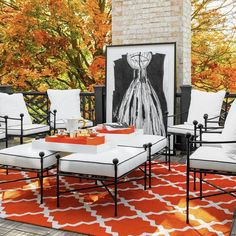 Orange and black patio features wrought iron chairs surrounding wrought iron ottomans covered in white cushions with black piping atop an orange trellis outdoor rug finished with a black lattice railing. Deck With Pergola, Pergola Patio, Black Pergola, Curved Pergola, Pergola Cover, Outdoor Rooms, Outdoor Living, Outdoor Art, Porches