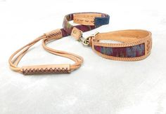 """FREE SHIPPING WORLDWIDE!   THIS IS ONE OF OUR FAVORITE DOG COLLAR & LEASH SETS!   IT'S A DOUBLE LAYER OF TOOLING LEATHER SO ITS INCREDIBLY STRONG.  THE PANELS ARE ALL INDIVIDUALLY DYE HAND RUBBED, MAKING IT A TRUE BOHEMIAN COLLAR.   THE INSERT IS FABRIC WE SOURCED IN BALI INDONESIA.   IT'S AN INDIGENOUS PATTERN AND COLOR COMBINATION.    THE LEASH MEASURES 54"""" LONG.  PRODUCT WARNING: WEARING THIS COLLAR, YOUR DOG MIGHT START ASKING QUESTIONS ABOUT SPIRITUALITY AND DRINKING KOMBUCHA."""