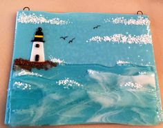 """Fused glass lighthouse on a restless sea. """"As You Wish"""" by Janelle."""