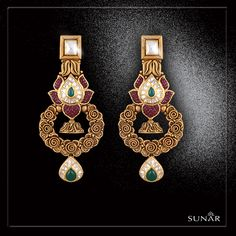 An antique pair of Earrings dazzled with precious stones with a detailing that will surely sway your hearts off. Our mind-boggling Earrings are designed exclusively in the house of Sunar to add a perfect allure in your inner shine and will allow you gleam well in your special quirky moments. 