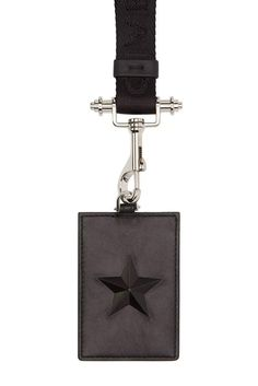 Nothing makes you feel more like a corporate drone than having to tote your company ID badge around in a cheap plastic lanyard. So step it up. Slyly stick it to the man by using this leather Givenchy badge holder instead. Sure, it's expensive, but you use your ID badge everyday. Black star badge holder ($420) by Givenchy, ssense.com   - Esquire.com