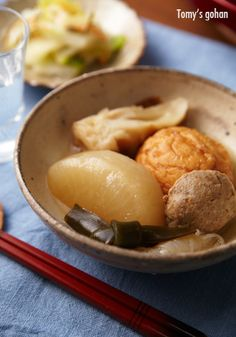 Oden, Japanese winter dish with daikon radish, konnyaku, and fish paste cakes stewed in a light dashi broth. おでん