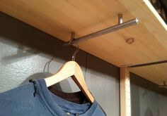 Use under a cabinet or shelf in laundry room to corral hangers