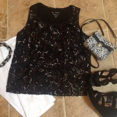 NWOT Chico's lace and sequined tank Wow, this is a beautiful Chico's black tank featuring both lace and sequins on the front and lace only on the back.  The body is 60% cotton/40% modal, the outer shell is 100% nylon.  A great piece for a fun night out on the town or a special celebration.  Chico's size 1 equals a women's size 10/12 Chico's Tops Tank Tops