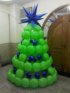 Balloon Christmas tree. The blue mylar stars produce a nice contrast to the lime green latex balloons.