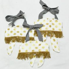 Baby bellies are the cutest there is, now show them off with this glitzy fringe crop top. Striped halter straps tie at the neck, and the bodice ties at the back, which allows this crop top to grow with your child. Leave size in notes upon checkout: 6m, 12m, 2t, 3t or 4t.