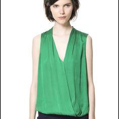 Green Zara Top Gorgeous silky deep green Zara top. Subtle diamond print throughout. Draping at front with deep V neckline. Slight hi-low hems. Zara Tops