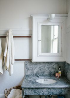original soapstone in this vintage bathroom that includes 6ft long wooden dowels & a claw foot tub in a San Francisco home