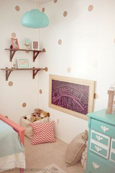 Vintage Mint and Coral Nursery with reclaimed wood décor Reveal.  Glitter vinyl polka dot wall decals and reading nook.  Shelves from ikea stained a distressed.