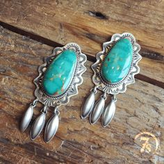 Logandale Earrings - Navajo handcrafted turquoise earrings. Entricate scallop detailed sterling silver setting and borders. Sterling silver rope trim setting. Kingman Turquoise oval stones.