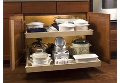"great article on where to put what in your kitchen.  e.g. "" if you have a blind corner or lazy susan cabinet, use that for heavier items like small appliances — light-weight items tend to get stuck and fall all over the place"""