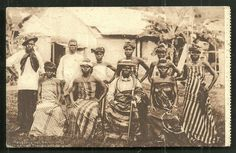 """Chief of Benin with his wives and children"" Vintage postcard, Nigeria, circa 1900."