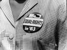 WASHINGTON — A close-up shows a civil rights protest button being worn by a female demonstrator at the March on Aug. 28, 1963.