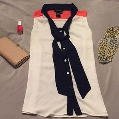 gorgeous summer blouse Gorgeous!! Ecru, navy and coral sheer button down blouse. Gently pre owned! Excellent condition. Tags states XS but fits like a small. Tops Button Down Shirts