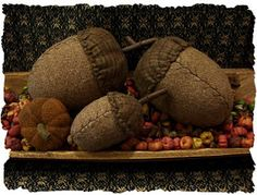 I love these acorns. Make the nut out of burlap and the cap out of material.