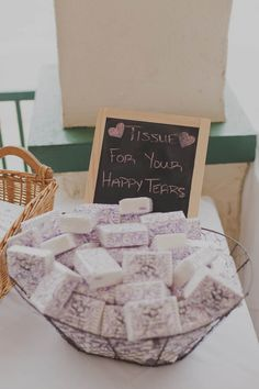 "Adorable wedding idea! Have a basket of ""Tissues for your happy tears"" at your ceremony entrance"