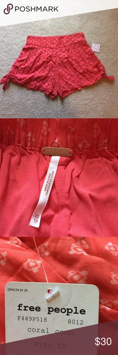 Free People soft coral rayon shorts NEW xs NWT. 100% rayon with lining. Ties on the ends. Cute pockets. Super drapey Free People Shorts