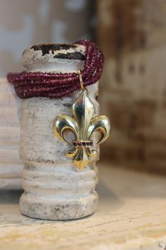Fleur de Lis pendant on rhodalite garnet necklace