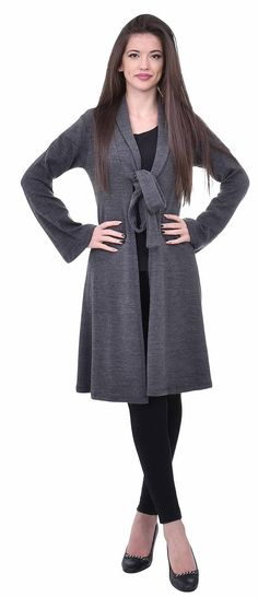 Dark gray women cardigan, made of knitted fabric. The cardigan is with comfortable for the winter length. The model is with long sleeves. The cardigan is for the ladiest, who want to look good everyday.