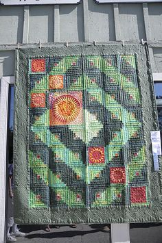 Love this quilt!!! The insertion of the starburst blocks kicks this quilt up several notches for me!!  Great idea!!