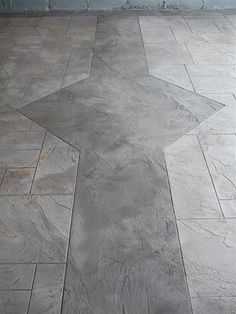 At The Floor Company, custom work doesn't stop with choosing custom colours or sheen finishes for your decorative concrete flooring. We can provide etched patterns, decorative staining, custom logo,  graphics and embedded HD imagery right onto your floor.