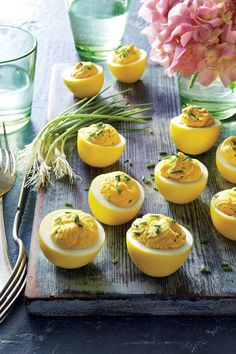 Deviled eggs get way more interesting when the eggs are pickled in a tangy brine that also dyes them a lovely color. The brine features turmeric, an Easter Recipes, Appetizer Recipes, Holiday Recipes, Appetizers, Easter Ideas, Easter Deviled Eggs, Easter Side Dishes, Food Dishes, Eggs