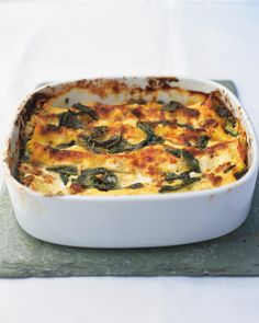 baked cannelloni  ingredients:  • a handful of Parmesan, grated  • 2 x 250g tubs of mascarpone  • 100g taleggio cheese, grated  • zest and juice of 2 lemons  • a handful of chopped walnuts  • 180g bag of baby spinach, chopped  • sea salt and freshly ground black pepper  • 20g pack of fresh sage  • 2 knobs of butter  • 1 packet of fresh lasagne – 12 sheets