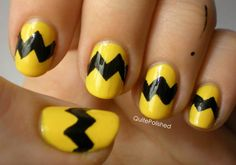 At first I thought pikachu but its actually Charlie brown nails!