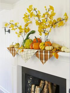 Use printed-fabric squares, colorful gourds and leaves, and silk ginkgo branches to create a fireplace display that can stay up until Thanksgiving.  #autumn #fall