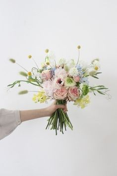 ) With a beautiful bouquet of flowers on Mother's Day, take some time to … Flower Boquet, Floral Bouquets, Wedding Bouquets, Wedding Flowers, Purple Bouquets, Bridesmaid Bouquets, Brooch Bouquets, Purple Wedding, Hands Holding Flowers