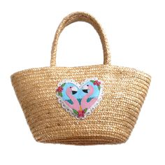 * Oooh, this one off bag is possibly my most favourite bag ever!* Customised straw bag with leather applique flamingo heart* Super kitsch and looks delightful with a summery fifties style outfit* Pink candy striped ribbon bow fastens the basket at the top* Measures approximately 35cm x 20cm x 12cm at widest points