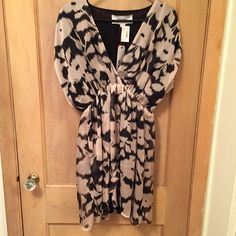 NEW LOW PRICE! R•89 Dress Size Medium R•89 Dress, from Boston Store. Size Medium. Black & champagne. Never worn. New with tags. Non-smoking home. Outside fabric layer, 100% polyester. Underneath fabric layer, 100% rayon. R•89 Dresses