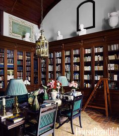 In his 16th-century French countryside estate, William Christie transformed a bare room into a library, outfitted with Cuban mahogany shelves salvaged from a library in Nantes. His carpenter found more Cuban mahogany to build the barrel-vault ceiling. The classical busts crowning the shelves are copies made by Lorenzani in Paris. - HouseBeautiful.com
