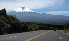 The Pan-American Highway winds past Cotopaxi in Volcano Alley