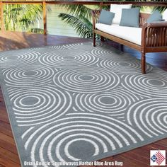 Soothing blues build concentric circles on Soundwaves area rug in Harbor Blue. This tone-on-tone floor covering lends a softness to your favorite relaxation spaces for a feeling thats second only to looking out on real waves. Surprisingly soft, yet extremely durable, this gorgeous...