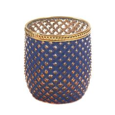 Glittering diamonds of light will enchant your room when you light a candle inside this exotic glass holder. Trimmed with golden metal, this patterned candle cu