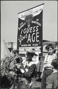 lets see..eh 16..  17?..20?  Lee Bennett - Hoppings Lee Bennett guessing people's ages at his 'I Guess Your Age' attraction at the Hoppings. 1952.