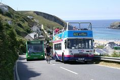 An Optare Solo belonging to now large Independent Western Greyhound passes the temporarily parked VR and a masochistic cyclist on the climb from Portreath. First Bus, Bus Coach, Coaches, Buses, Transportation, Competition, Park, Top, Trainers