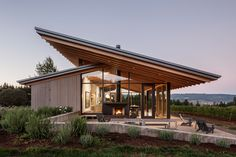 Surrounded by 23 acres of Oregon's wine country, the L'Angolo Estate Tasting Room is a reflection of the landscape around it. The structure is comprised of two cantilevered roofs, inspired by the neighboring oak trees. Underneath the oversized canopy sits...