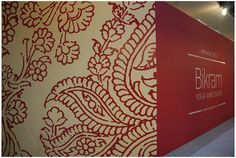 Bikram hoarding design. Really love the large floral pattern and the colour inversion on both walls between words, wall and image.