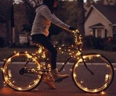 Bike wrapped in lights, i like this...fun bike ride with friends in the summer!