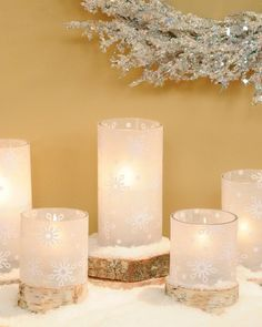 Snowflake Hurricane Candleholder  Make affordable snowflake hurricane wraps using little more than wax paper and repurposed grocery bags.