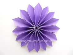 Cute Oragami Flower - You have to make lots of petals though to make this one.