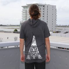 Grey longline tshirt, contrast drop tee with zip and ta moko maori artwork.